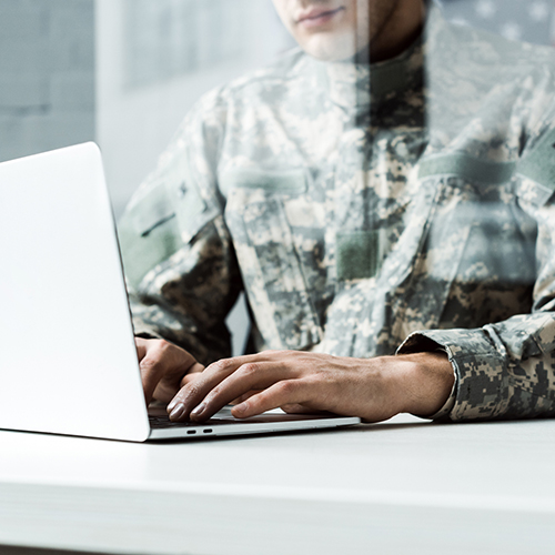 Military Member on Computer